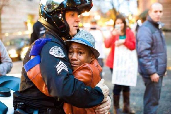 "Devonte Hart, holding a ""Free Hugs"" sign"