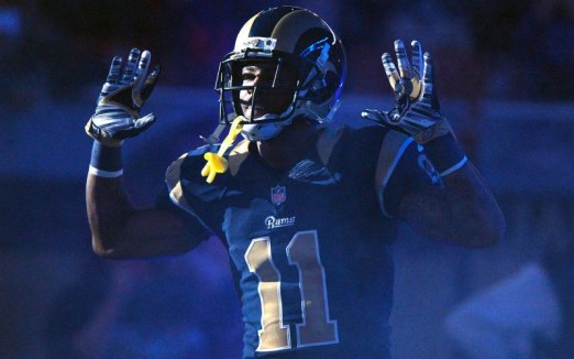 """Tavon Austin of the St. Louis Rams holds his hands up to signify """"Hands Up, Don't Shoot"""" in solidarity with people around the world protesting against police brutality  and for better accountability."""