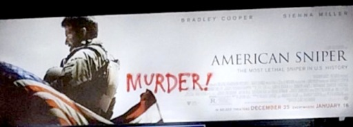 "An 'American Sniper' billboard is defaced with the word ""murder"" in West Los Angeles."