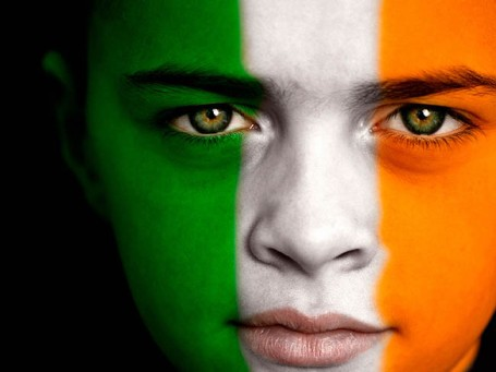 Portrait of a young Irish football / soccer fan, with the Irish Flag on his face.