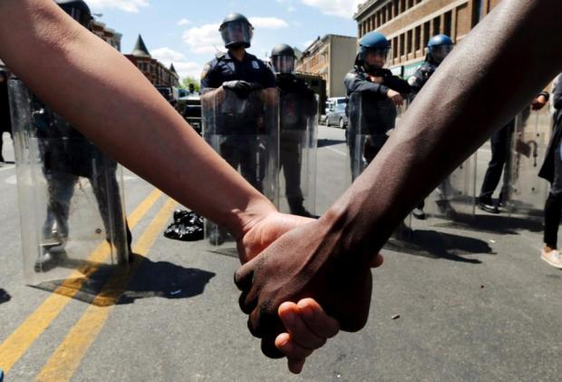 protesters-hold-hands-baltimore
