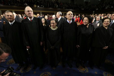 Supreme Court Justices, from left, Chief Justice John Roberts, Anthony Kennedy, Ruth Bader Ginsburg, Stephen Breyer, Sonia Sotomayor and Elena Kagan await the start of President Barack Obama's State of the Union address during a joint session of Congress on Capitol Hill in Washington, Tuesday Feb. 12, 2013. (AP Photo/Charles Dharapak, Pool)