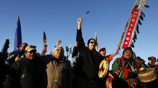 Native American self-styled water protectors celebrate at the Oceti Sakowin camp as news breaks that Dakota Access Pipeline construction has been halted. (Lucas Jackson/Reuters)