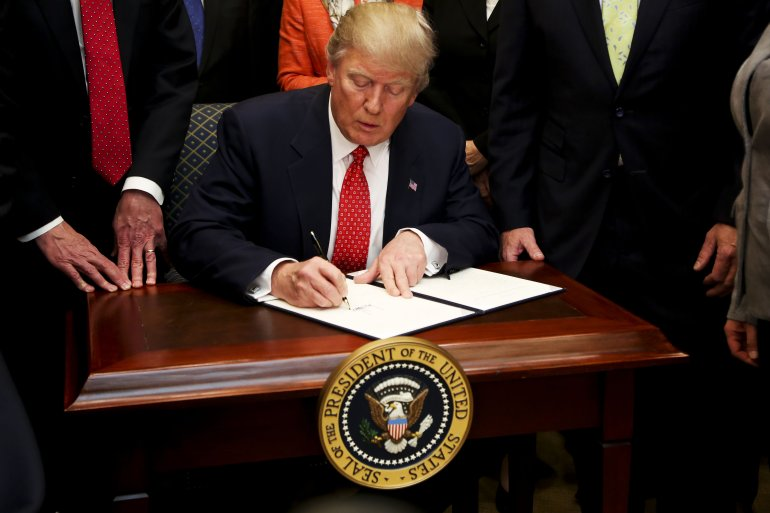 Image result for photo of president trump signing gun executive order