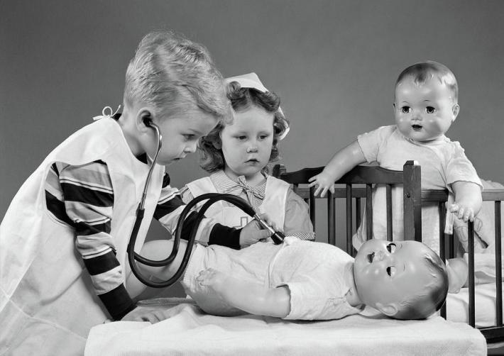 Vintage kids playing doctor